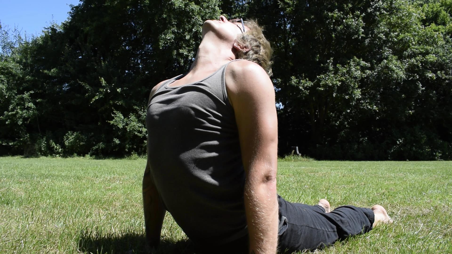 Laurence doing a yoga backbend - Upward Facing Dog. In Sudbury, Suffolk. Norwich