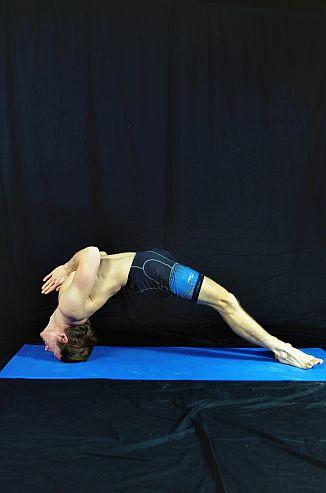 Yoga Pose Demonstration - Locked Bridge. In Sudbury, Suffolk & Norwich Norfolk.