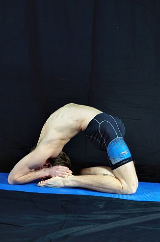 Yoga Pose demonstration - Pigeon Pose. In Sudbury, Suffolk & Norwich.