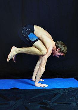 Yoga Pose demonstration - Crow Pose. In Sudbury, Suffolk & Norwich.