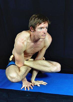 Yoga Pose Demonstration - Cockerel Pose. In Sudbury, Suffolk & Norwich